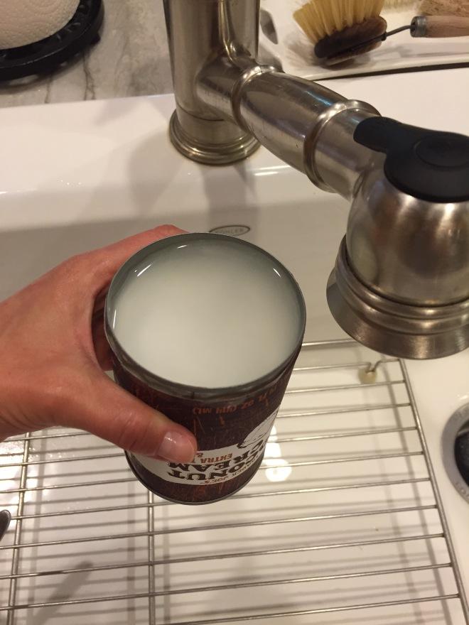 srtaining coconut cream